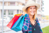 shopping time: woman with colored shopping bags - 274028322