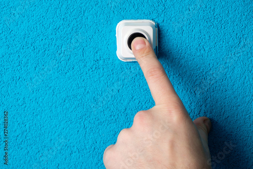 Fotografie, Obraz  Close-up of man's hand pressing the button of doorbell