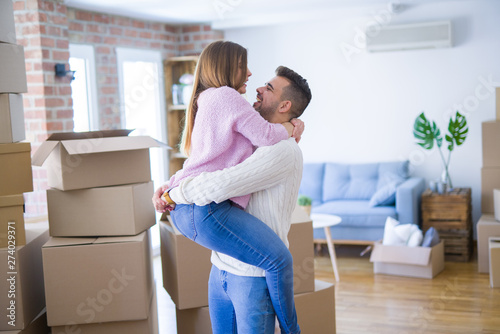 Fotografie, Obraz  Young beautiful couple hugging in love celebrating very happy moving to new apar