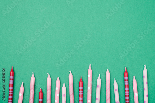 Fotografie, Obraz  Birthday candles on colorful background. Flat lay
