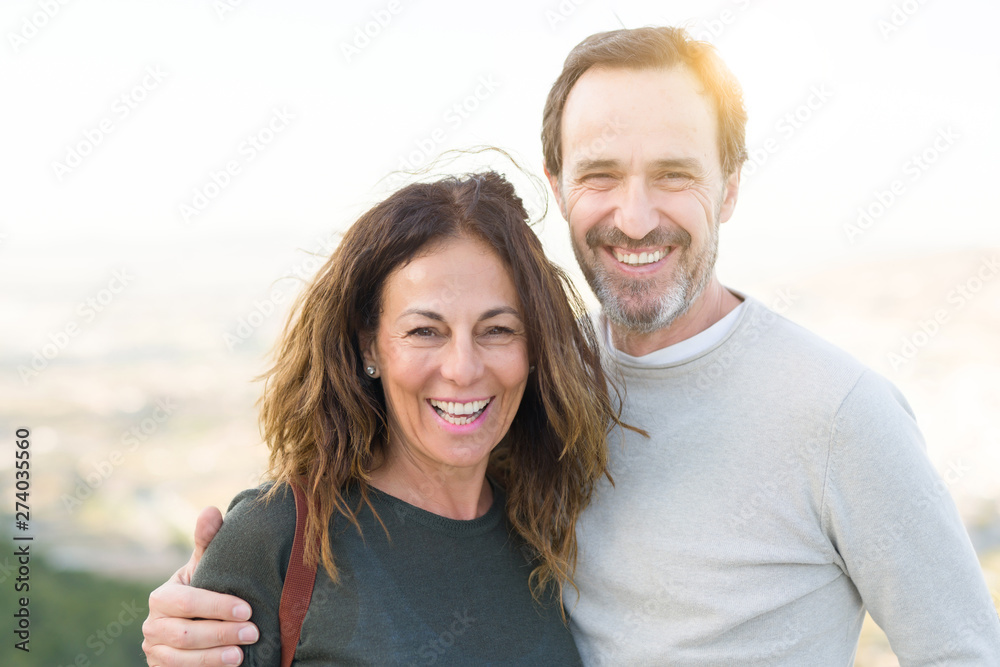 Fototapety, obrazy: Romantic couple smiling and cuddling on a sunny day
