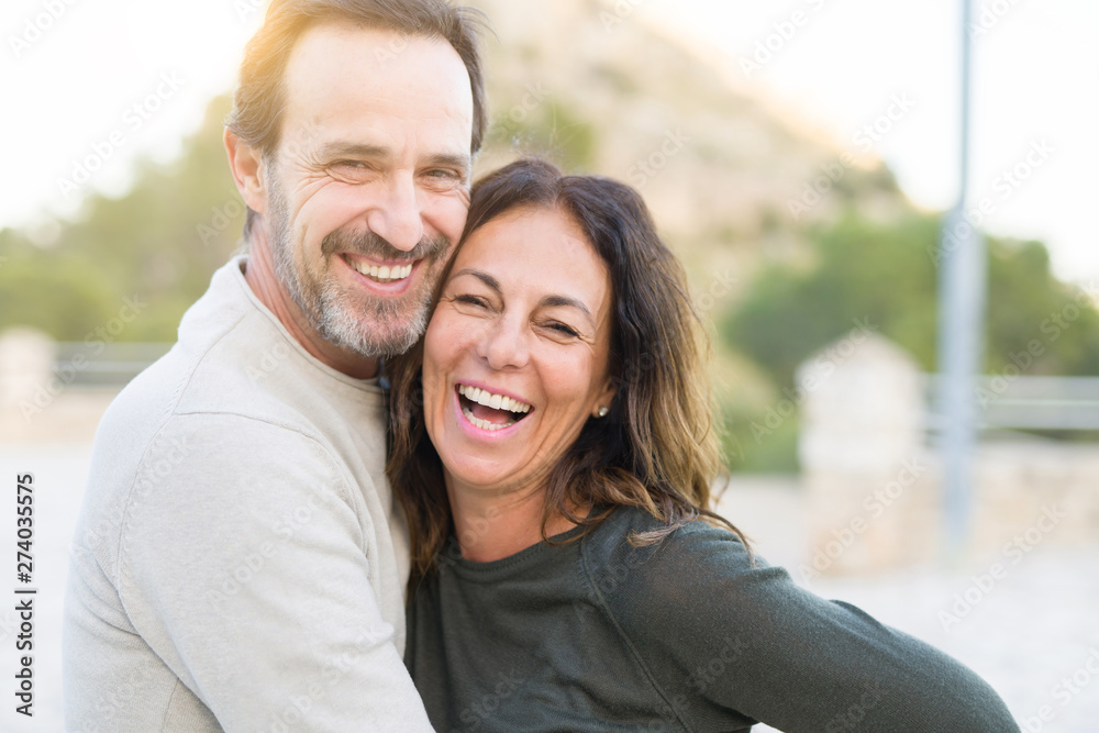 Fototapeta Romantic couple smiling and cuddling on a sunny day