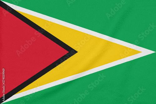 Photo sur Toile Amérique du Sud Flag of Guyana on textured fabric. Patriotic symbol