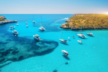 Aerial View Of Boats And Luxury Yachts In Transparent Sea At Sunny Day In Summer In Mallorca, Spain. Colorful Landscape With Bay, Azure Water, Green Trees, Blue Sky. Balearic Islands. Top View. Travel