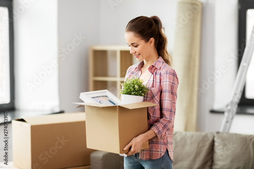 Obraz na plátně people, repair and real estate concept - smiling woman with stuff moving to new