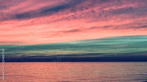 Photo Stands Candy pink Sunset ocean orange sky horizon