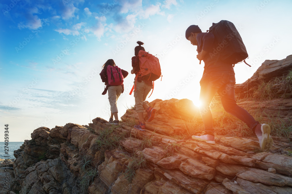 Fototapety, obrazy: Young asian couple climbing up on the mountain,hiking and team work concept.