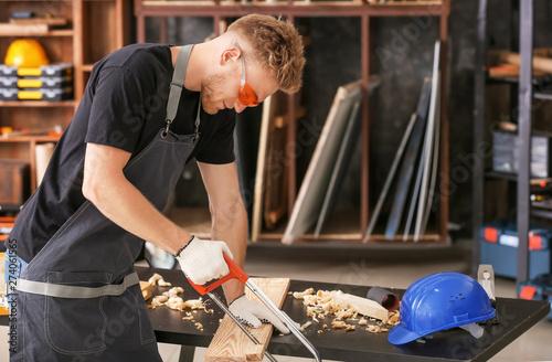 Obraz na plátně  Male carpenter working in shop