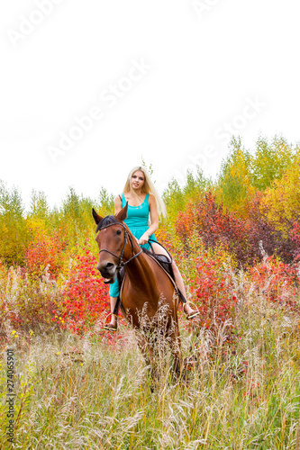Girl in long evening dress sits astride a horse Wallpaper Mural