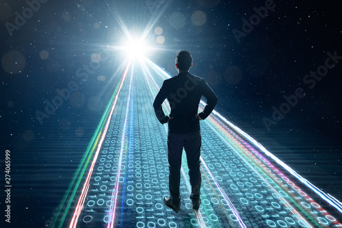 Canvastavla  Rear view of businessman standing on binary code numbers on motion lighting road , speed and faster digital matrix business technology information concept