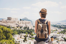 Traveler Girl Enjoying Vacations In Greece. Young Woman Wearing Hat Looking At Acropolis In Athens. Summer Holidays, Vacations, Travel, Tourism Concept.
