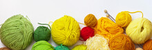 Panoramic Top View On Colorful Balls Of Yarn For Hand Knitting On A White Background. On Top Empty Space For Text. Flat Lay, Closeup