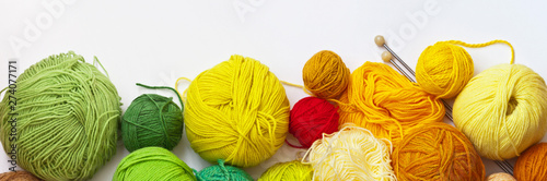 Fotografía Panoramic top view on colorful balls of yarn for hand knitting on a white background