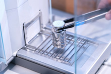 Stainless Steel Calibration Weight To Place On The Analytical Balance For Calibration Test.