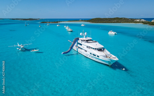 Photo Aerial Drone view of Motor Yacht Boat in Islands Bahamas Beaches