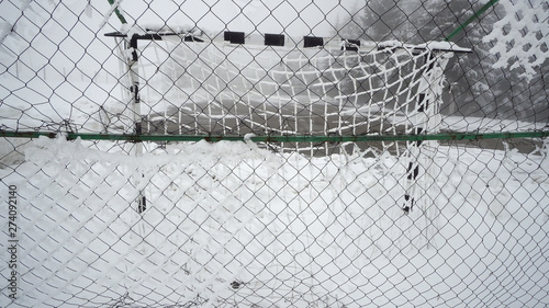 Sport practicing terrain for handball or football covered with snow