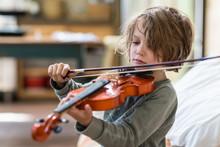 5 Year Old Boy Playing Violin At Home