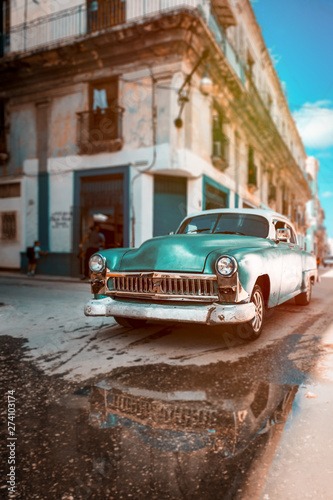 Poster Havana Antique car with reflections on a water puddle in Old Havana