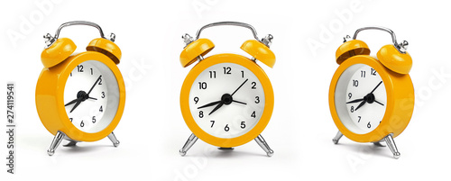 Stampa su Tela Three yellow alarm clock over white