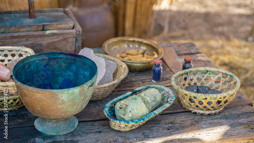 Fototapeta Utensils, handmade dyeing of fabrics and wool in a cauldron with colored dyes in a medieval fair in Spain obraz