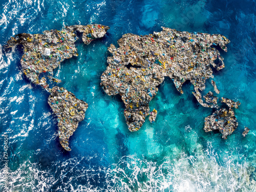 Obraz Continents earth are made up of garbage, surrounded by ocean water. Concept environmental pollution with plastic and human waste - fototapety do salonu