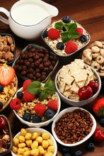 Cereal. Bowls Of Various Cereals, Berries And Milk For Breakfast. Muesli With Kids Cereals.