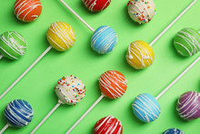 Bright Delicious Cake Pops On Color Background, Flat Lay