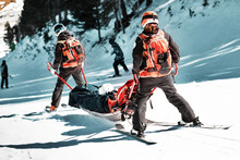 Rescuers At A Ski Resort Evacu...