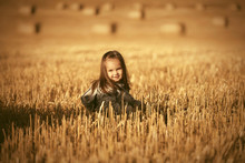 Happy Two Year Old Girl Walking In Summer Harvested Field