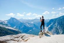 Vlogger On A Mountain Top