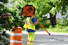 Outdoor Worker Hold Slow Sign ...