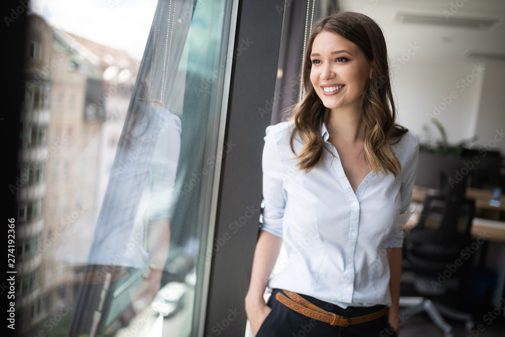 Fototapeta Successful business woman looking confident and smiling