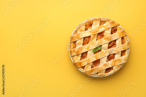 Tasty peach pie on color background Canvas Print