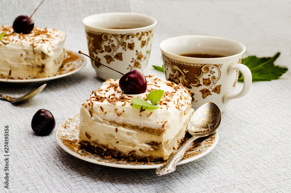 Fototapety, obrazy: Tiramisu, a traditional Italian dessert in a light background. Close-up