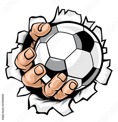 A strong hand holding a soccer football ball tearing through the background Canvas Print