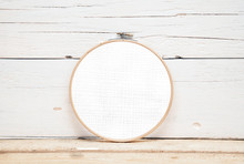 Hoops For Embroidery On A Wooden Background - A Round Layout For Embroidery