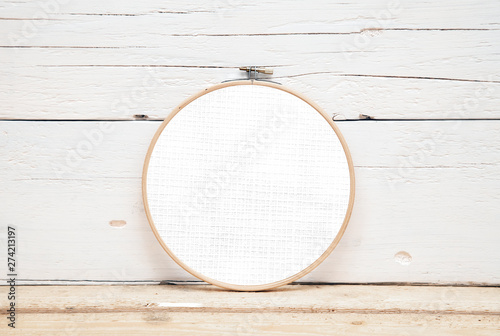 Photo hoops for embroidery on a wooden background - a round layout for embroidery