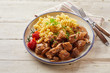Leinwandbild Motiv Hot plate of pasta and meat next to utensils