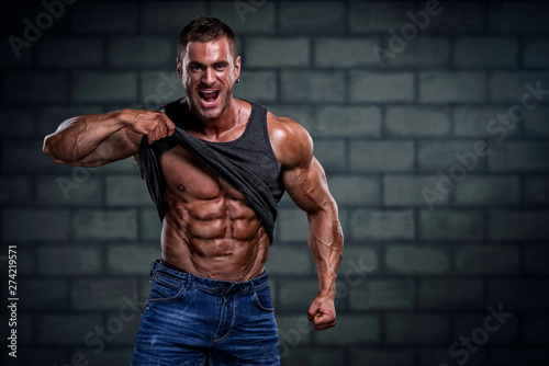 Handsome Bodybuilder Showing Abdominal Muscles Canvas Print