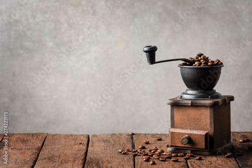 Retro coffee grinder on wooden table Canvas