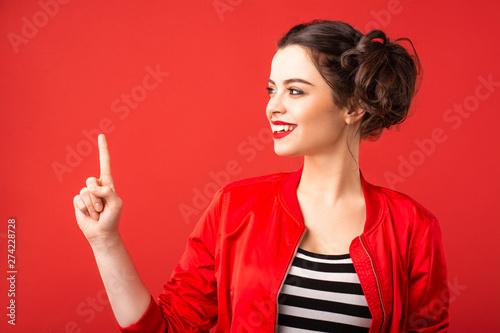 Emotional brunette girl on a red background