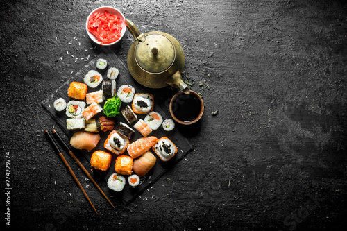 Recess Fitting Sushi bar Various kinds of Japanese sushi rolls with ginger and soy sauce.