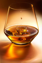 Whisky Drop Falling Into Glass Of Whisky