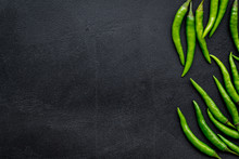 Fresh Green Chilli Pepper As Food Ingredient On Black Table Background Top View Mockup