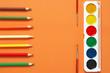 Leinwanddruck Bild - Colorful drawing items set on orange
