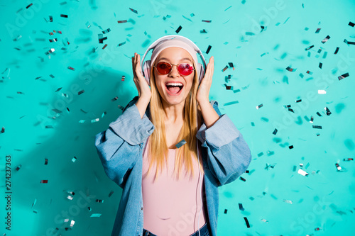 Portrait of nice charming attractive cheerful glad excited girl wearing sun eyeglasses eyewear sound audio soul jazz pop hit cool song isolated on bright vivid shine blue green turquoise background - 274237363