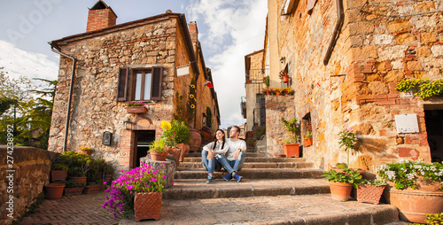 Beautiful Tourist Couple In Love Enjoying Rest In The Old City At Sunset