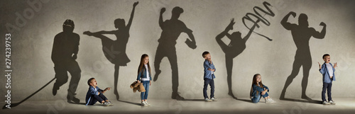 Fototapeta Childhood and dream about big and famous future. Conceptual image with boy and girl and shadows of fit athlete, hockey player, bodybuilder, ballerina. Creative collage made of 2 models. obraz