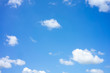 The sky is bright blue. There are clouds floating through. Feel relax when looking. See the sun on the sun.