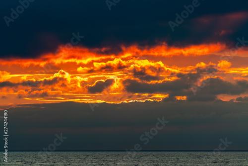 Valokuva  Impressive sky on fire after sunset with orange clouds